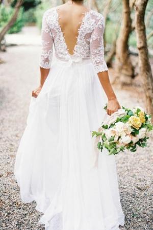 الأكمام الضيقة خامة الرقي التي تميز فستان العروس لموسم خريف 2016