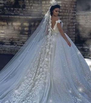 كوني عروس ملكية بأحدث فساتين زفاف فخمة